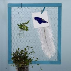 A Notice Board made from framed Chicken Wire Netting