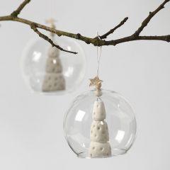 A white Clay Christmas Tree inside a Glass baseless Bauble