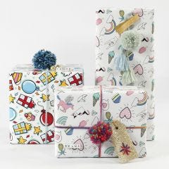 Gift wrapping with wrapping Paper, Yarn and Decorations