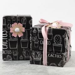 Gift wrapping decorated with a Card Flower