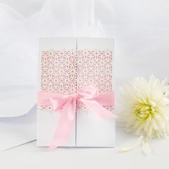 A Wedding Invitation decorated with Lace patterned Card and Satin Ribbon