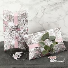 Pillow Boxes decorated with pink Ribbon, a Metal Ring and Card Flower Cut-Outs