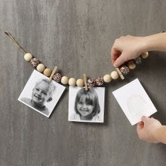 Pictures on a Piece of natural Twine with wooden Beads, Pegs and Sequins