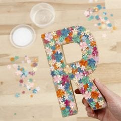 A Papier-mâché Letter decorated with Sequins and Sticky Base