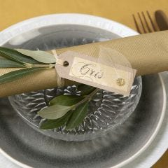 A place card from recycled card  decorated with a skeleton leaf
