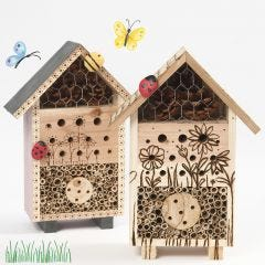 An insect hotel or a bug's b&b decorated with a pyrography tool and painted stones