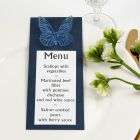 A blue Menu Card with a punched-out Butterfly