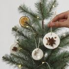 Hanging decorations made from self-hardening clay decorated with natural materials