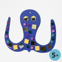 A flat wooden decorative Shape painted and decorated with Mosaics