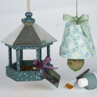 Decorated flowerpot and bird table for bird food for the winter