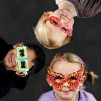 A Card Mask shaped like a Pair of Glasses