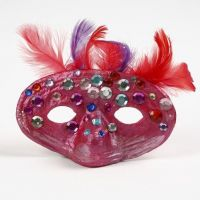 A Papier-Mâché Mask with Feathers and Rhinestones
