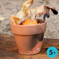 Bread made on a Bonfire in a Lined Red Terracotta Flower Pot