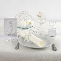 An Invitation and Table Decorations for a White Wedding