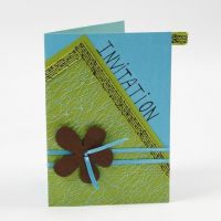 A Greeting Card with netted Fabric and a Flower on Satin Ribbon
