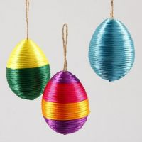 Papier-mâché Easter eggs wound round with satin cord