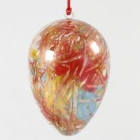 A two-part transparent acrylic Egg with an abstract Painting
