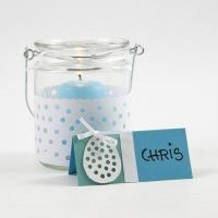 A Candle Holder with a punched paper Waistband