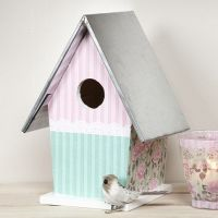 A painted and decoupaged wooden Bird Box with a Zinc Roof