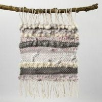 A woven Picture from Cotton Yarn, Wool and Strips of Fabric