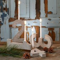 An Advent Candle Holder made from four Concrete Numbers