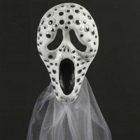 A Scream mask decorated with wiggle Eyes and Organza
