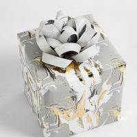 Gift wrapping decorated with a Rosette made from Paper Star Strips