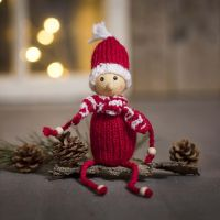 An elf knitted from acrylic yarn with wooden beads for hands and feet