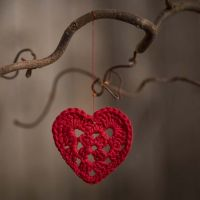 A small heart crocheted from cotton yarn