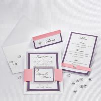 A Wedding Card with a silver Card Frame and textured Paper