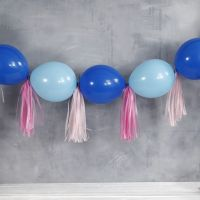 A Garland from connected Balloons and Tassels