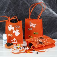 A Trick or Treat Bag decorated with Craft Paint, Stamped Designs and Eyes made from Stickers