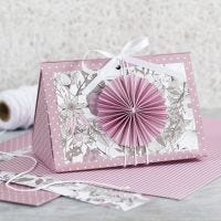 A rose Gift Box with a Rosette and Design Paper