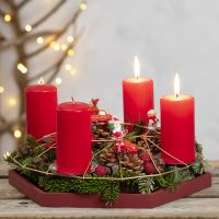 An Advent Wreath from a Metal Hanging Decoration decorated with Spruce, Pine Cones and Miniature Figures