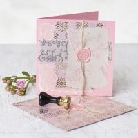 A Greeting Card decorated with handmade Paper, printed Designs, Wax and Seal