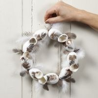 A wreath with plastic eggs and guinea fowl feathers