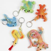 Fabric creepy-crawlies decorated with finger paint