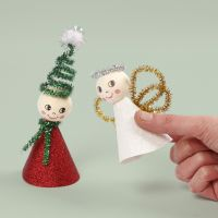 An elf and an angel from glitter design paper