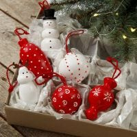 Wooden figures and wooden Christmas baubles for hanging decorated with craft paint