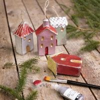 Christmas houses for hanging decorated with metallic paint and glitter