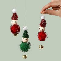 Elves for hanging made from pipe cleaners, pom-poms and bells