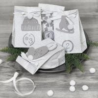 Advent calendar presents decorated with paper decorations and pom-poms