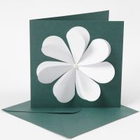 A greeting card with a flower made from punched-out hearts