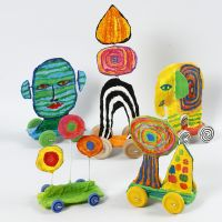 Sculptures on wheels from recycled cardboard and gauze bandage