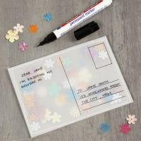 A post card made from vellum paper and filled with sequins