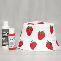 A bucket hat decorated with painted strawberries